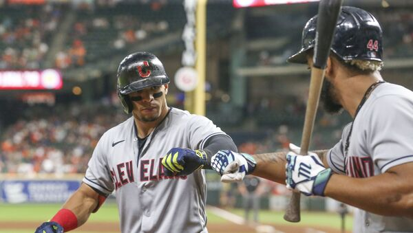 Cleveland Indians designated hitter Bobby Bradley (44)  congratulates second baseman Cesar Hernandez (7) on his home run against the Houston Astros in the seventh inning at Minute Maid Park.  - Sputnik International