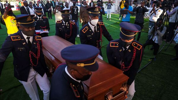 Pallbearers in military attire carry the coffin holding the body of late Haitian President Jovenel Moise after he was shot dead at his home in Port-au-Prince earlier this month, in Cap-Haitien, July 23, 2021. REUTERS/Ricardo Arduengo - Sputnik International