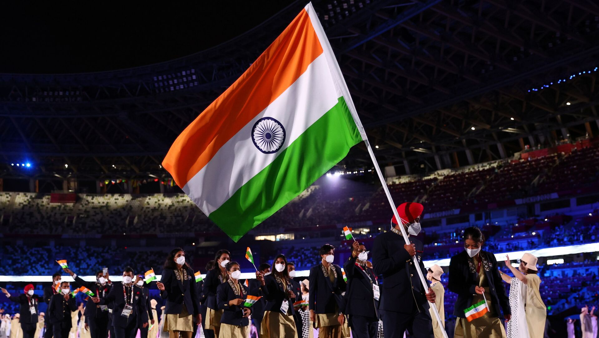 Tokyo 2020 Olympics - The Tokyo 2020 Olympics Opening Ceremony - Olympic Stadium, Tokyo, Japan - July 23, 2021. Flag bearers Harmanpreet Singh of India and Mary Kom Hmangte of India lead their contingent during the athletes' parade at the opening ceremony REUTERS/Kai Pfaffenbach - Sputnik International, 1920, 23.07.2021