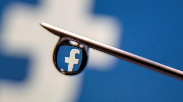 Facebook logo is reflected in a drop on a syringe needle in this illustration photo taken 16 March 2021 - Sputnik International