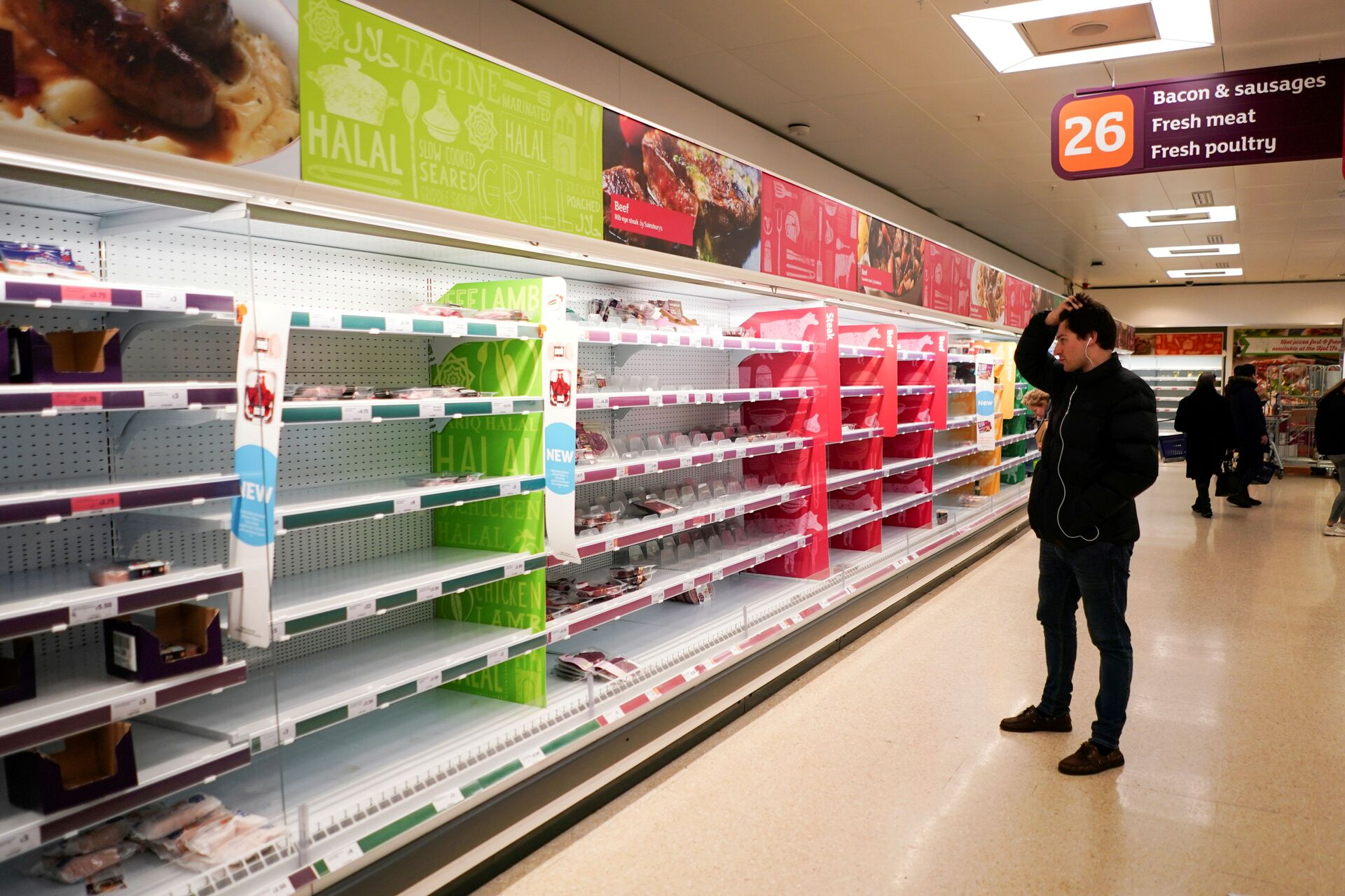 FILE PHOTO: A man stands next to shelves empty of fresh meat in a supermarket, as the number of worldwide coronavirus cases continues to grow,  in London, Britain, March 15, 2020 - Sputnik International, 1920, 07.09.2021