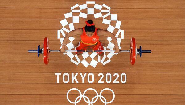 Tokyo 2020 Olympics - Weightlifting - Women's 49kg - Group A - Tokyo International Forum, Tokyo, Japan - July 24, 2021.  Mirabai Chanu Saikhom of India in action. Pool via REUTERS/Chris Graythen - Sputnik International
