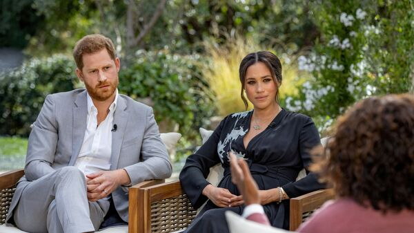 Britain's Prince Harry and Meghan, Duchess of Sussex, are interviewed by Oprah Winfrey in this undated handout photo. - Sputnik International