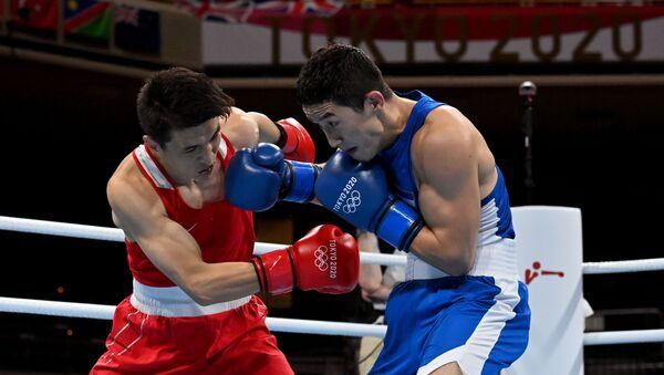 Tokyo 2020 Olympics - Boxing - Men's Lightweight - Last 32 - Kokugikan Arena - Tokyo, Japan - July 25, 2021. Elnur Abduraimov of Uzbekistan in action against Baatarsukh Chinzorig of Mongolia  - Sputnik International