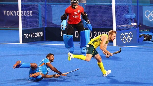 Tokyo 2020 Olympics - Hockey - Men's Pool A - India v Australia - Oi Hockey Stadium, Tokyo, Japan - July 25, 2021. Rupinder Pal Singh of India in action with Daniel Beale of Australia. REUTERS/Bernadett Szabo - Sputnik International