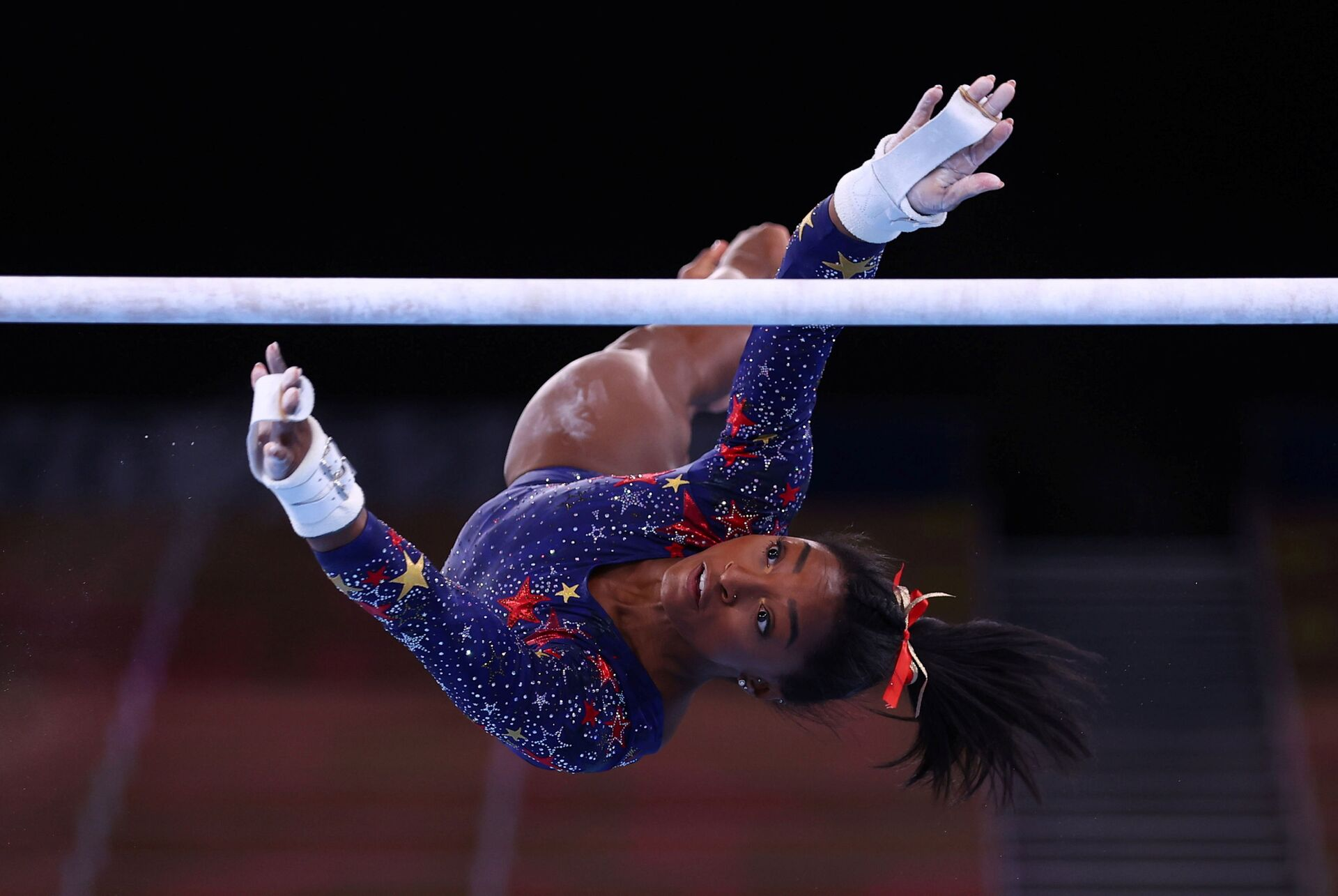 Tokyo 2020 Olympics - Gymnastics - Artistic - Women's Uneven Bars - Qualification - Ariake Gymnastics Centre, Tokyo, Japan - July 25, 2021. Simone Biles of the United States in action during the uneven bars REUTERS/Mike Blake/File photo  SEARCH OLYMPICS DAY 3 FOR TOKYO 2020 OLYMPICS EDITOR'S CHOICE, SEARCH REUTERS OLYMPICS TOPIX FOR ALL EDITOR'S CHOICE PICTURES. - Sputnik International, 1920, 07.09.2021