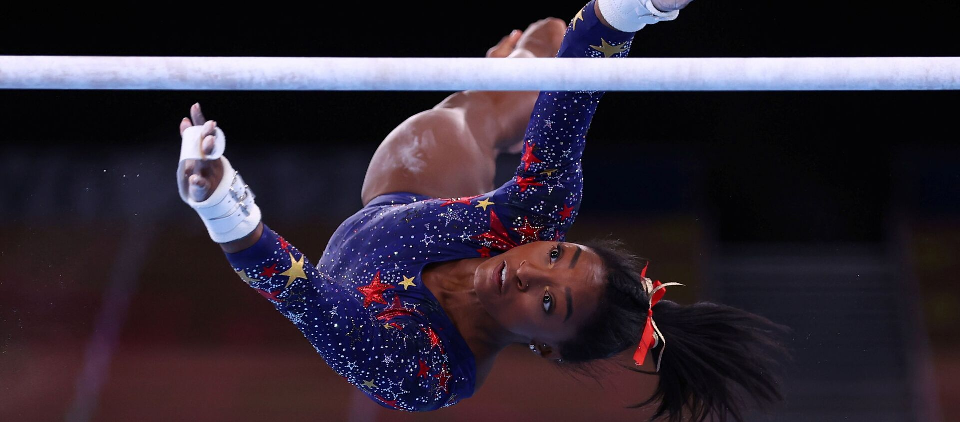 Tokyo 2020 Olympics - Gymnastics - Artistic - Women's Uneven Bars - Qualification - Ariake Gymnastics Centre, Tokyo, Japan - July 25, 2021. Simone Biles of the United States in action during the uneven bars REUTERS/Mike Blake/File photo  SEARCH OLYMPICS DAY 3 FOR TOKYO 2020 OLYMPICS EDITOR'S CHOICE, SEARCH REUTERS OLYMPICS TOPIX FOR ALL EDITOR'S CHOICE PICTURES. - Sputnik International, 1920