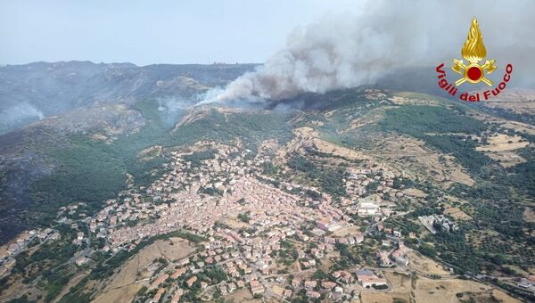 An aerial view from a helicopter shows a large wildfire that broke out near Santu Lussurgiu, Sardinia, Italy July 25, 2021. - Sputnik International