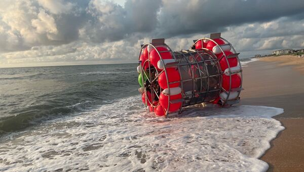 A bubble-like vessel washed ashore in Florida on July 24, 2021. - Sputnik International