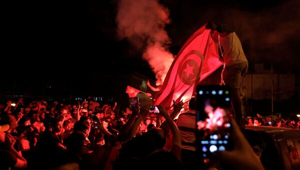 Supporters of Tunisia's President Kais Saied gather on the streets as they celebrate after he dismissed the government and froze parliament, in Tunis, Tunisia July 25, 2021. - Sputnik International