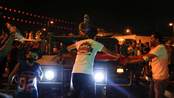 A military vehicle drives on a street as supporters of Tunisia's President Kais Saied gather after he dismissed the government and froze parliament, in Tunis, Tunisia July 25, 2021. - Sputnik International
