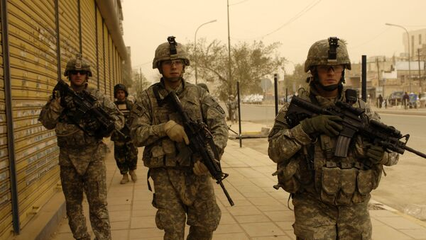 U.S. Army Soldiers assigned to 5th Battalion, 25th Field Artillery Regiment, 4th Brigade Combat Team, 10th Mountain Division, Iraqi National Police from 3rd Battalion, 1st Brigade Combat Team, 1st Division and Iraqi army soldiers conduct a search mission for illegal firearms and improvised explosive device caches in Baghdad, Iraq, March 15, 2008. - Sputnik International
