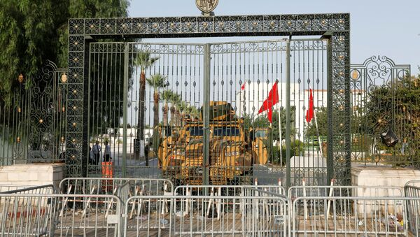 A military vehicle is pictured in front of the parliament building in Tunis, Tunisia  July 26, 2021. - Sputnik International