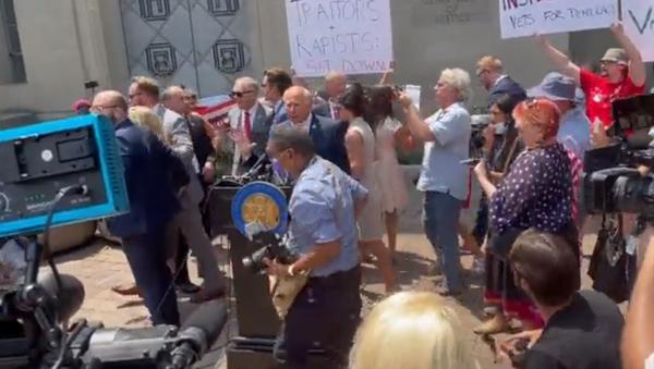 US Reps. Matt Gaetz (R-FL), Marjorie Taylor Greene (R-GA), Louie Gohmert (R-TX) and Paul Gosar (R-AZ) flee from protesters outside the US Department of Justice on July 27, 2021 - Sputnik International