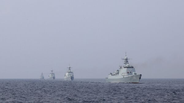 A destroyer formation leading by the Type 052 guided-missile destroyer Kunming (Hull 172) steams at an undisclosed sea area during a maritime actual combat training exercise in late April, 2018. They are attached to a destroyer flotilla with the navy under the PLA Southern Theater Command. - Sputnik International