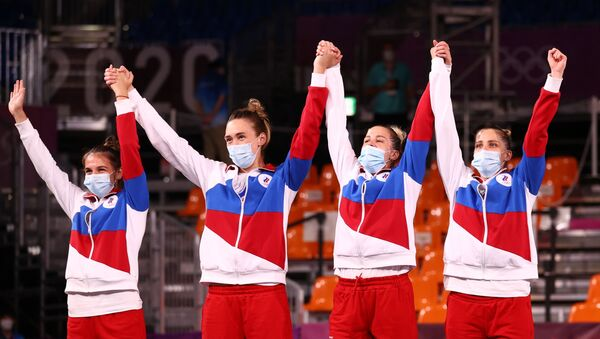 Tokyo 2020 Olympics - Basketball 3x3 - Women - Medal Ceremony - Aomi Urban Sports Park, Tokyo Japan - July 28, 2021. Silver medallists Anastasiia Logunova of the Russian Olympic Committee, Evgeniia Frolkina of the Russian Olympic Committee, Olga Frolkina of the Russian Olympic Committee, Yulia Kozik of the Russian Olympic Committee pose for a picture as they wear face masks.  - Sputnik International