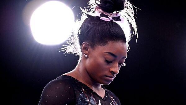 FILE PHOTO: Tokyo 2020 Olympics - Gymnastics Artistic Training - Ariake Gymnastics Centre, Tokyo, Japan - July 22, 2021 Simone Biles of the United States during training - Sputnik International