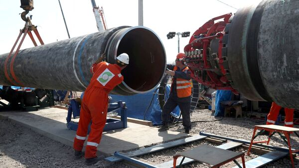 FILE PHOTO: Workers are seen at theconstruction siteof the NordStream2 gas pipeline, near the town of Kingisepp, Leningrad region, Russia, June 5, 2019 - Sputnik International