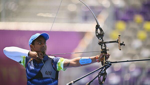Tokyo 2020 Olympics - Archery - Men's Individual - 1/16 Finals - Yumenoshima Archery Field, Tokyo, Japan - July 29, 2021. Atanu Das of India in action  - Sputnik International