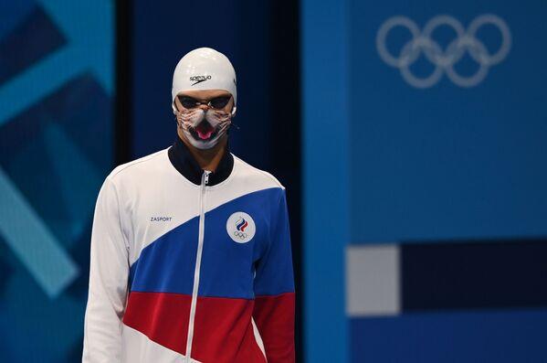 Russian athlete Evgeny Rylov preparing for the men's 100m backstroke race at the 2020 Summer Olympics in Tokyo, Japan. - Sputnik International