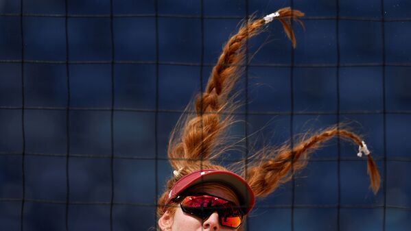 Kelly Claes of the US beach volleyball team during their match against Latvia at the Tokyo 2020 Olympics. - Sputnik International