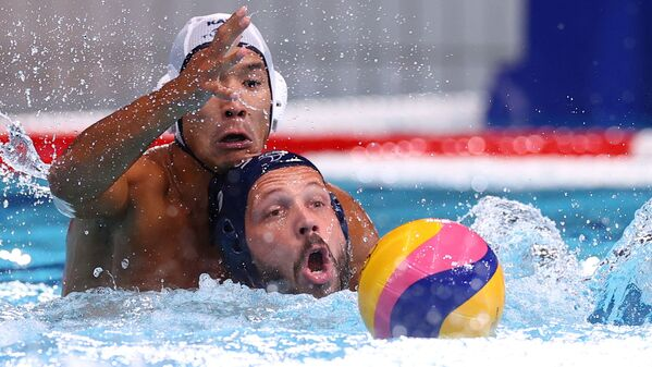 Dusan Mandic of Serbia and Murat Shakenov of Kazakhstan clash during a water polo match at the Tatsumi Water Polo Centre during the Tokyo 2020 Olympics. - Sputnik International