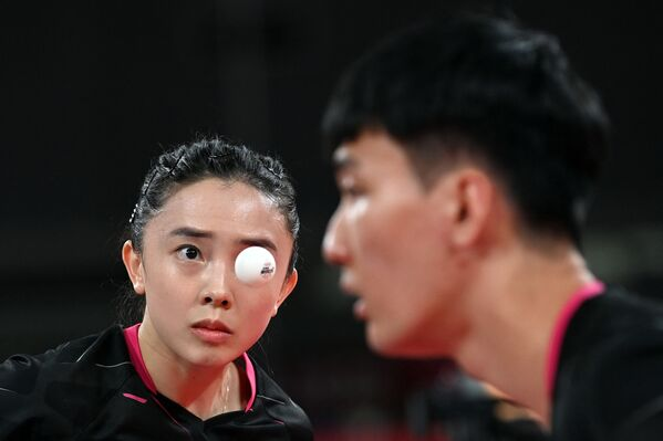 South Korea's Lee Sang-su (R) and Jeon Ji-hee compete against Taiwan's Lin Yun-ju and Cheng I-ching during their mixed doubles quarterfinals table tennis match at the Tokyo Metropolitan Gymnasium during the Tokyo 2020 Olympic Games. - Sputnik International