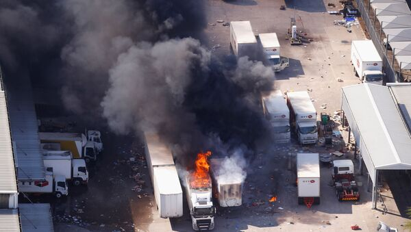 A general view of burning trucks after violence erupted following the jailing of former South African President Jacob Zuma, in Durban, South Africa, July 14, 2021 - Sputnik International