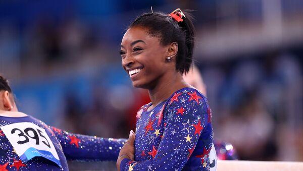 Tokyo 2020 Olympics - Gymnastics - Artistic - Women's Individual All-Around - Qualification - Ariake Gymnastics Centre, Tokyo, Japan - July 25, 2021. Simone Biles of the United States reacts - Sputnik International