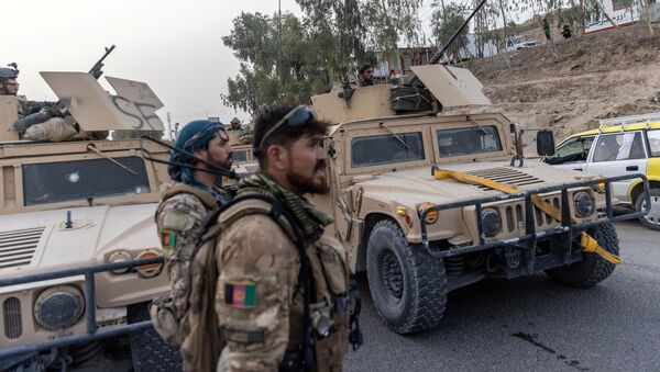 A convoy of Afghan Special Forces is seen during the rescue mission of a policeman besieged at a check post surrounded by Taliban, in Kandahar province, Afghanistan, July 13, 2021 - Sputnik International