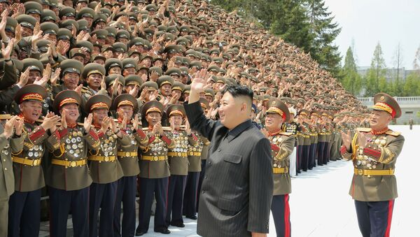 North Korea's leader Kim Jong Un greets participants of the first workshop of the commanders and political officers of the Korean People's Army (KPA) in Pyongyang, North Korea in this image supplied by North Korea's Korean Central News Agency on July 30, 2021.   - Sputnik International