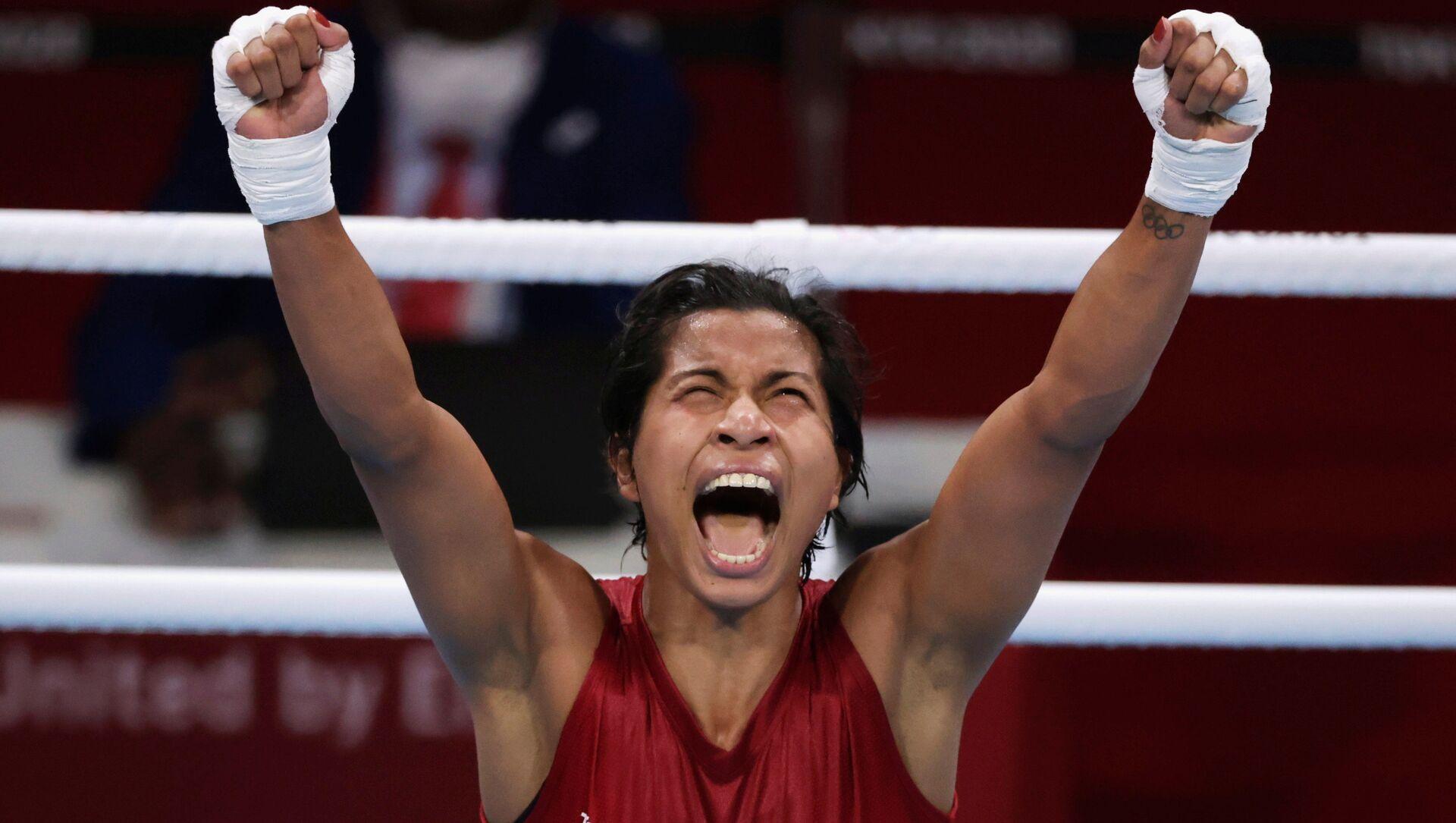 Tokyo 2020 Olympics - Boxing - Women's Welterweight - Quarterfinal - Kokugikan Arena - Tokyo, Japan - July 30, 2021. Lovlina Borgohain of India celebrates after the fight against Chen Nien-Chin of Taiwan. - Sputnik International, 1920, 30.07.2021