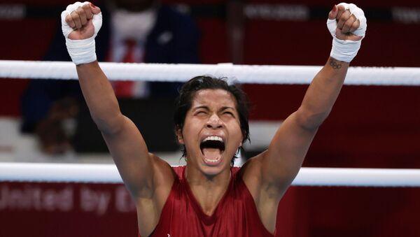 Tokyo 2020 Olympics - Boxing - Women's Welterweight - Quarterfinal - Kokugikan Arena - Tokyo, Japan - July 30, 2021. Lovlina Borgohain of India celebrates after the fight against Chen Nien-Chin of Taiwan. - Sputnik International