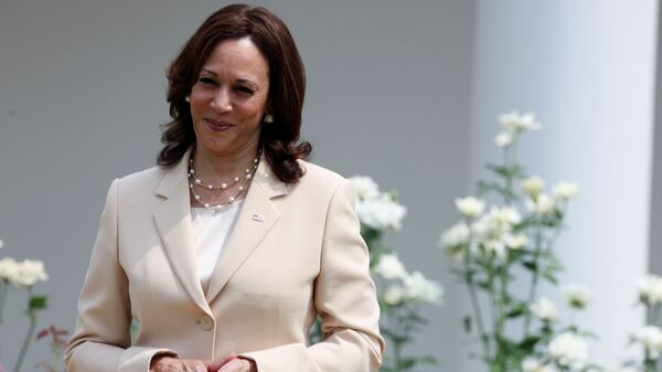 U.S. Vice President Kamala Harris stands by during an event to celebrate the 31st anniversary of the Americans with Disabilities Act (ADA) in the White House Rose Garden in Washington, U.S., July 26, 2021 - Sputnik International