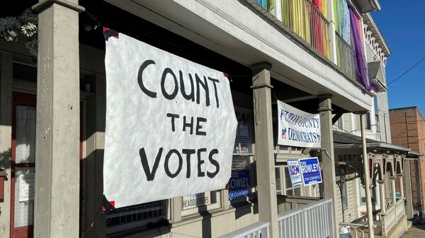 A sign urging people to vote is seen on the porch of the Democratic Party's Fulton County headquarters on Election Day in McConnellsburg, Pennsylvania November 3, 2020. Picture taken November 3, 2020. - Sputnik International