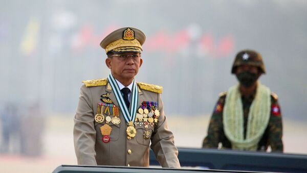 FILE PHOTO: Myanmar's military ruler Min Aung Hlaing presides over an army parade on Armed Forces Day in Naypyitaw, Myanmar, March 27, 2021. REUTERS/Stringer//File Photo - Sputnik International