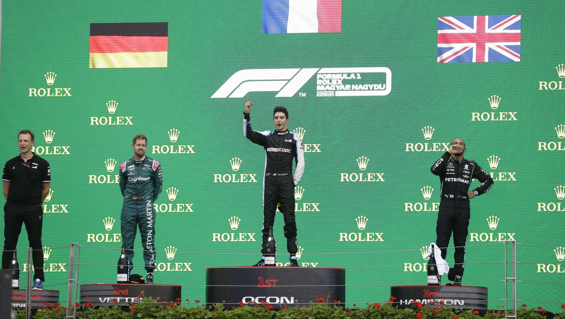 Formula One F1 - Hungarian Grand Prix - Hungaroring, Budapest, Hungary - August 1, 2021 Second placed Sebastian Vettel of Aston Martin, first placed Esteban Ocon of Alpine and third placed Lewis Hamilton of Mercedes on the podium after the race  - Sputnik International, 1920, 01.08.2021