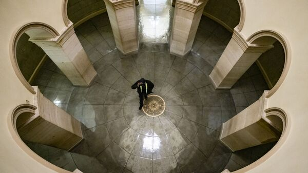 A US Capitol Police officer walks through the US Capitol Building on 1 August 2021 in Washington, DC. Congress is working to come to an agreement to pass President Biden's proposed infrastructure bill before they head into their August recess on the 9th.  - Sputnik International