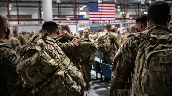 FORT DRUM, NEW YORK - DECEMBER 08: U.S. Army soldiers from the 10th Mountain Division arrive from a 9-month deployment in Afghanistan on December 08, 2020 in Fort Drum, New York. - Sputnik International