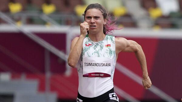 Kristina Timanovskaya, of Belarus, runs in the women's 100-meter run at the 2020 Summer Olympics, Friday, July 30, 2021.  - Sputnik International