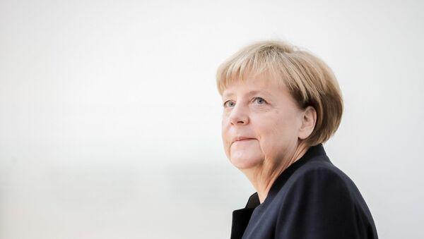 German Chancellor Angela Merkel arrives at the Israeli embassy in Berlin to sign the book of condolence for Israeli ex-president and Nobel Peace Prize winner Shimon Peres on September 30, 2016. - Sputnik International