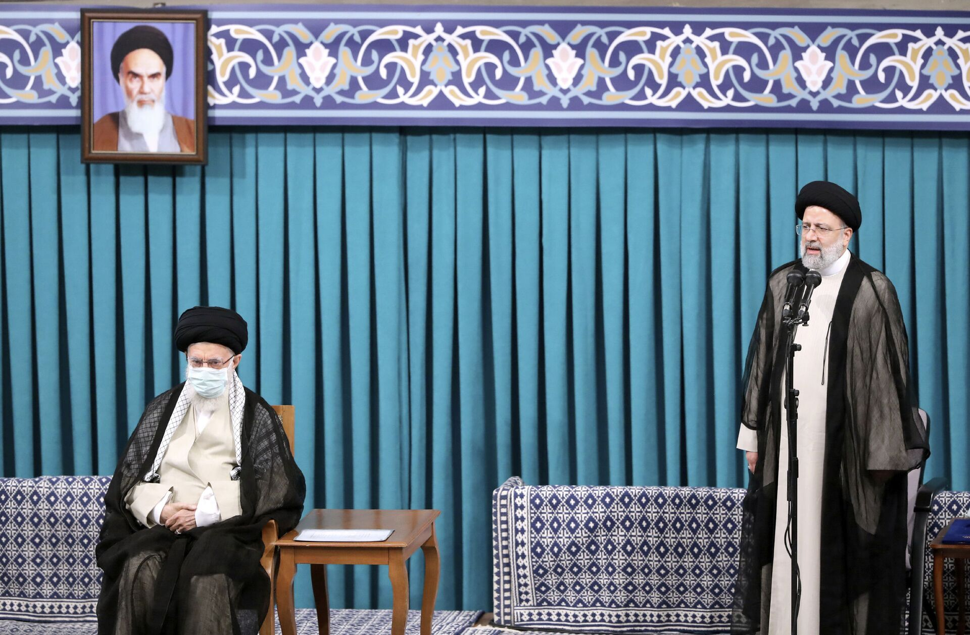 In this photo released by an official website of the office of the Iranian supreme leader, newly elected President Ebrahim Raisi, right, speaks after receiving official seal of approval of Supreme Leader Ayatollah Ali Khamenei, left, in an endorsement ceremony in Tehran, Iran, Tuesday, Aug. 3, 2021. - Sputnik International, 1920, 07.09.2021