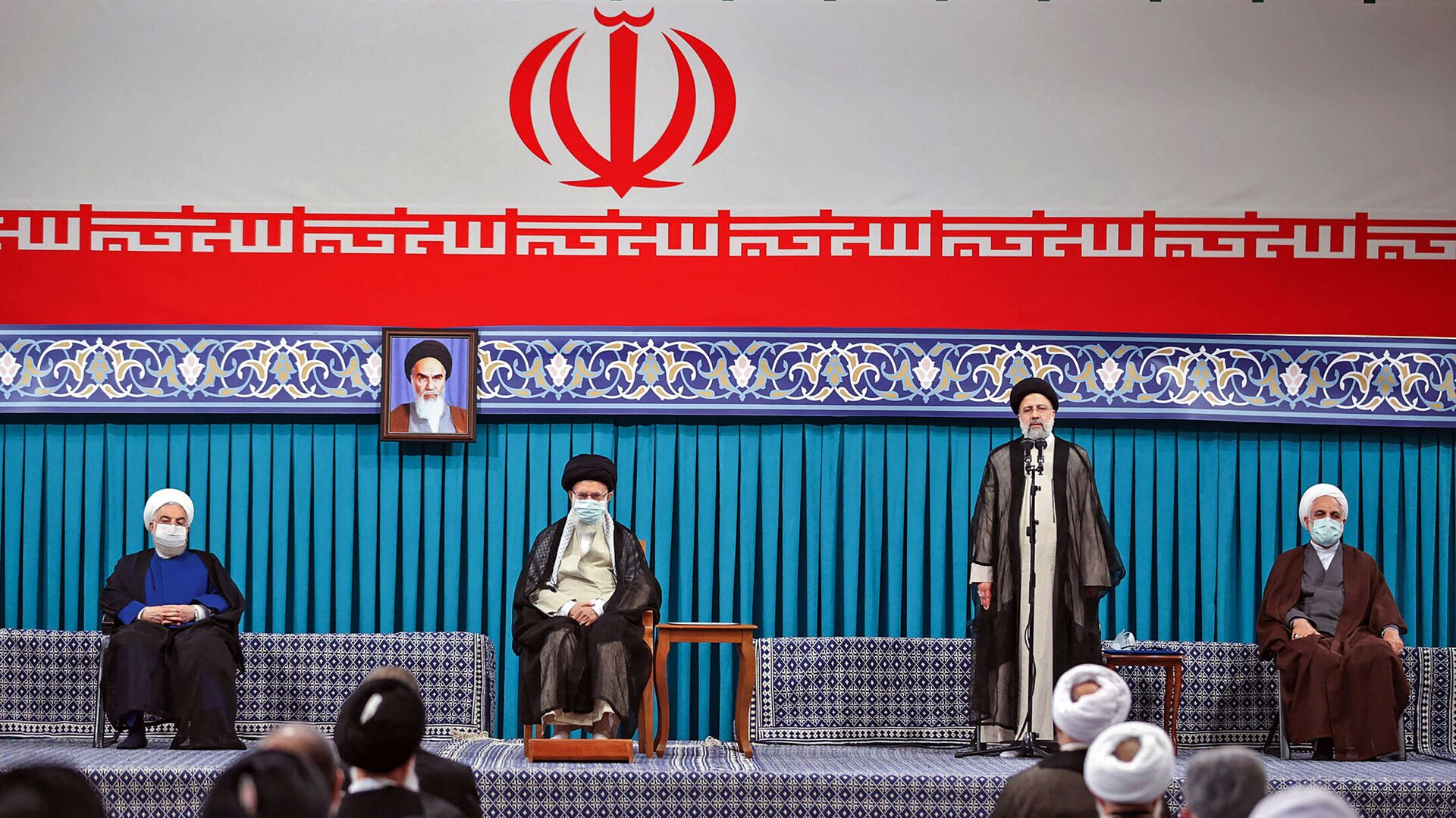 A handout picture provided by the office of Iran's Supreme Leader Ayatollah Ali Khamenei on August, 3 2021 shows him (C L) flanked by outgoing president Hassan Rouhani (L) during the inauguration ceremony for Ebrahim Raisi (C R) in the presence of the head of judiciary authority Gholamhossein Mohseni-Ejei (R) in Khamenei's office in the capital Tehran. - Sputnik International, 1920, 03.08.2021