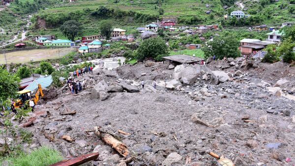 Rescue workers search for survivors after a landslide caused by heavy rains at Rulehar village in the Kangra district of the northern state of Himachal Pradesh, India, July 13, 2021.  - Sputnik International