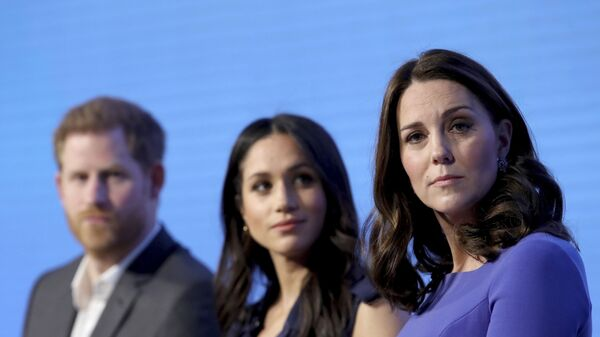 In this Wednesday, Feb. 28, 2018 file photo, Britain's Kate, Duchess of Cambridge, right, with Prince Harry and his fiancee Meghan Markle attend the first annual Royal Foundation Forum in London. - Sputnik International