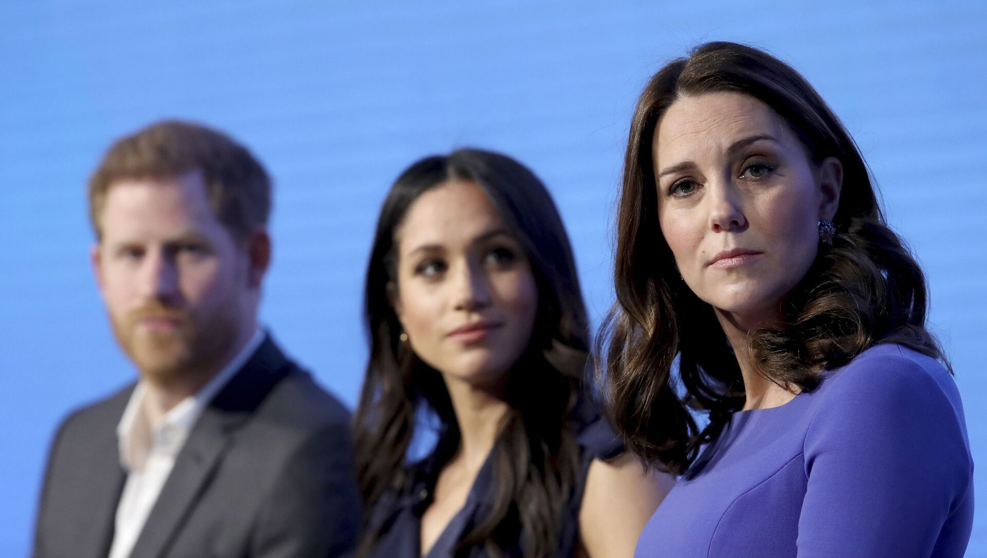 In this Wednesday, Feb. 28, 2018 file photo, Britain's Kate, Duchess of Cambridge, right, with Prince Harry and his fiancee Meghan Markle attend the first annual Royal Foundation Forum in London. - Sputnik International, 1920, 04.08.2021