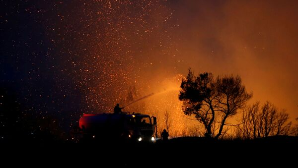 Firefighters try to extinguish a wildfire in the suburb of Varympompi, north of Athens, Greece, August 3, 2021.  - Sputnik International