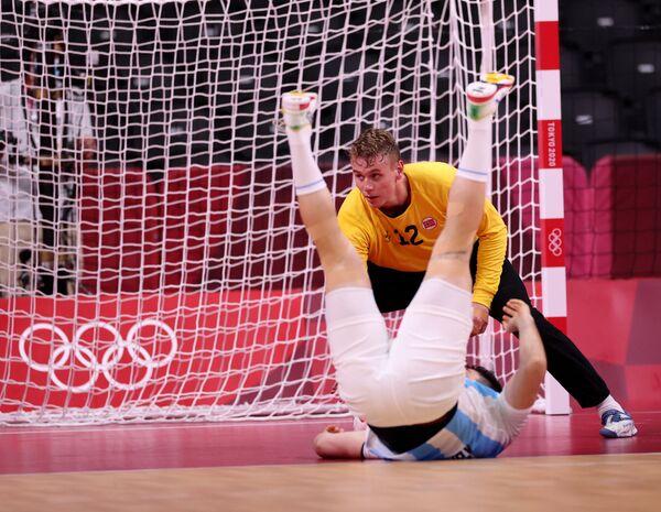 Kristian Skinstad Saeveraas of Norway in action as an Argentinean player falls to the floor. Handball - Men - Group A, Yoyogi National Stadium - Sputnik International