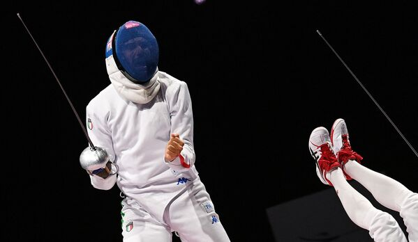 Italy's Enrico Garozzo (L) reacts as Japan's Koki Kano falls down during a men's epee individual qualifying bout.  - Sputnik International