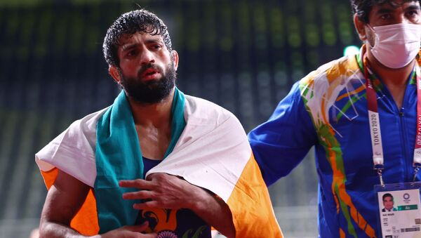 Ravi Kumar of India after winning in the semi-final at the Tokyo 2020 Olympics for the Wrestling (Freestyle) in the  Men's 57kg category. Makuhari Messe Hall A, Chiba, Japan on 4 August 2021. - Sputnik International